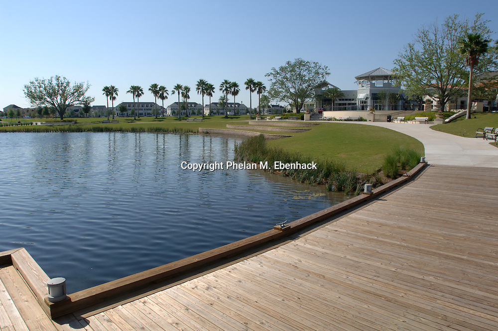 A waterfront walking path surrounds a lake in the downtown portion of the Baldwin Park neighborhood in Orlando, Florida.