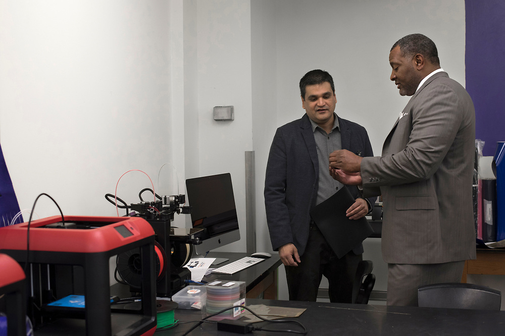 Superintendent Dr Anthony Hamlet inspects an object created by a 3D printer with PTSA president Ashish Badjatia at the grand opening of Google Maker Space at Obama Academy.