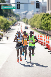 Boston Athletic Association 10K road race: lead pack of men, all Kenyan, led by Geoffrey Mutai