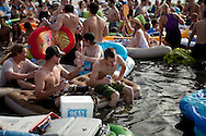Revelers enjoy the Floatopia event in Mission Bay near Fanuel Street Park in San Diego, March 20, 2010. Roughly 5,000 people took to the water to skirt an alcohol ban on San Diego's beaches.