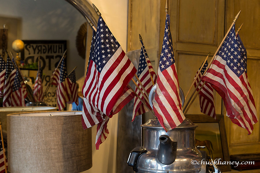 American flags on display in antique shop on the 4th of July in Aspen. Colorado, USA