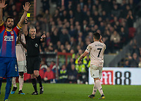 Football - 2018 / 2019 Premier League - Crystal Palace vs. Manchester United<br /> <br /> Referee Martin Atkinson points to and gives Alexis Sanchez (Manchester United) a yellow card at Selhurst Park.<br /> <br /> COLORSPORT/DANIEL BEARHAM