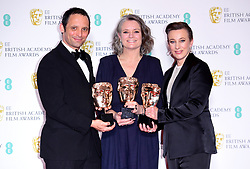 Mark Jenkin, Linn Waite and Kate Byers with their award for Best Outstanding Debut by a British Writer, Director or Producer in the press room at the 73rd British Academy Film Awards held at the Royal Albert Hall, London.