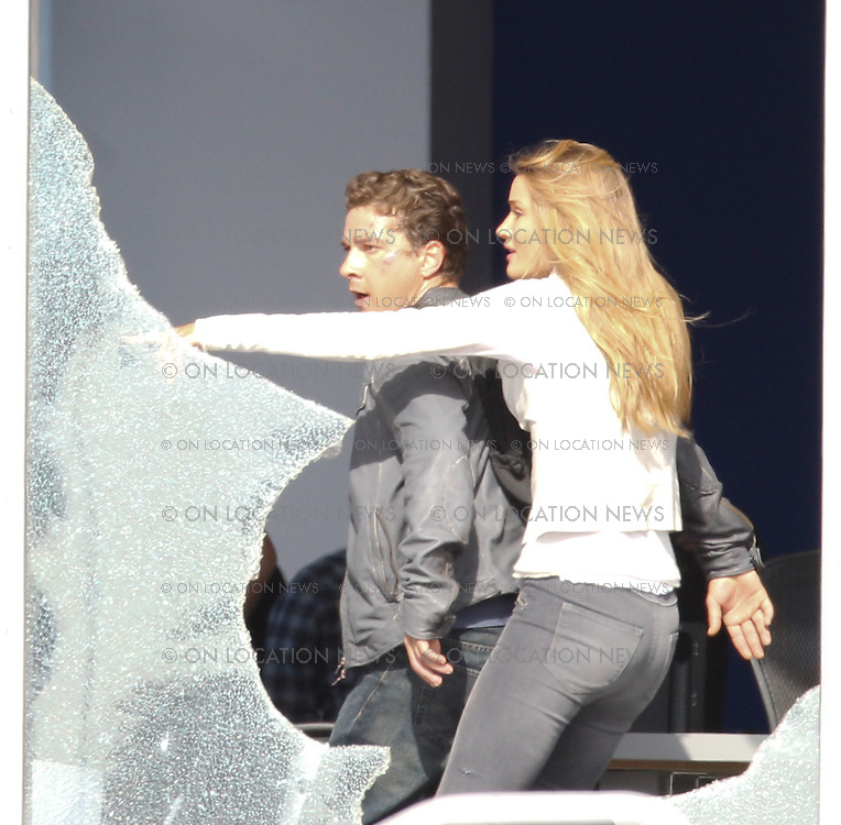 June 17th 2010 <br /> Los Angeles, California. <br /> <br /> ***WORLD EXCLUSIVE***<br /> <br /> The very first photos of  Shia LaBeouf and Rosie Huntington-Whiteley filming Transformers 3. Director Michael Bay and actor Tyreese are also photographed. <br /> <br /> This thrilling action scene involves Shia and Rosie being chased by an evil Decepticon Transformer and the US military trying to fend off the evil robot. As Shia and Rosie run for safety through an office building, the Decepticon tips the building over. For this scene one floor of an office building was built on a giant platform that tilts to an angle. <br /> <br /> All cast and crew appeared to be very happy working together and very focused on creating the &quot;greatest action film of all time&quot;. Later in the day, while filming continued, a big satellite TV was brought on the set to air the live championship game between the Los Angeles Lakers and the Boston Celtics. Everyone stopped working to watch the final few minutes of the exciting game. When the Lakers won, there were wild cheers and applause by most people on set including big Laker fan, Shia LaBeouf. <br /> <br /> Photo by Eric Ford/On Location News. <br /> 818-613-3955  info@onlocationnews.com