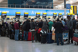 © licensed to London News Pictures. London, UK 19/01/2013. Passengers waiting in Heathrow Airport Terminal 5 on Saturday 19, January 2013 as many flights delayed due to snow in London. Photo credit: Tolga Akmen/LNP