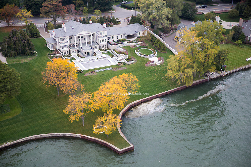 "An elaborately landscaped mansion sits on Lake Saint Clair. Less than nine miles from downtown Detroit, Grosse Point Farms is the city's ""upscale"" neighbor."