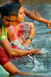 "India, Nasik, 2006. In India, ""puja'"" or cleansing, is an integral part of Hindu religious life. Pilgrims regard the waters of the Godavari to be sacred."