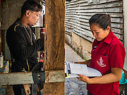 03 SEPTEMBER 2016 - BANGKOK, THAILAND: A Bangkok city worker (right) talks a Pom Mahakan resident about his home during an operation to evict people from the Pom Mahakan community. Hundreds of people from the Pom Mahakan community and other communities in Bangkok barricaded themselves in the Pom Mahakan Fort to prevent Bangkok officials from tearing down the homes in the community Saturday. The city had issued eviction notices and said they would reclaim the land in the historic fort from the community. People prevented the city workers from getting into the fort. After negotiations with community leaders, Bangkok officials were allowed to tear down 12 homes that had either been abandoned or whose owners had agreed to move. The remaining 44 families who live in the fort have vowed to stay.      PHOTO BY JACK KURTZ