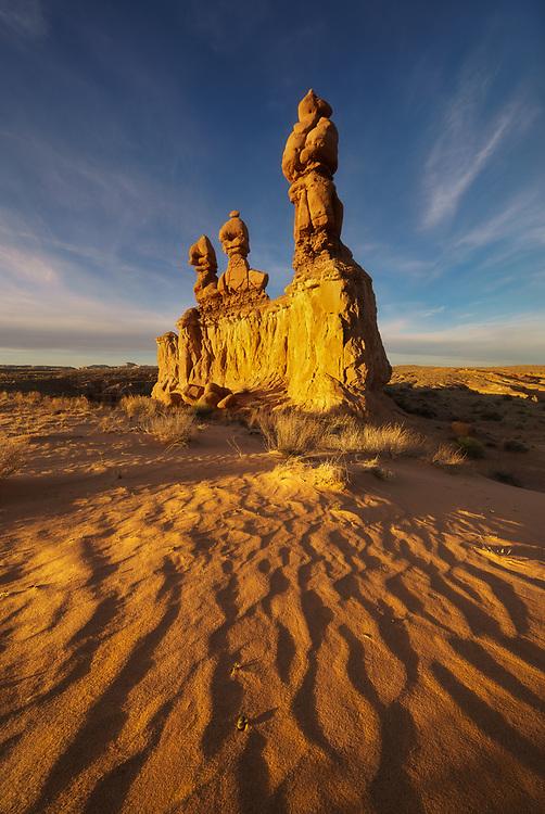 Warm light basking the desert landscape in Goblin Valley State Park, Utah, USA