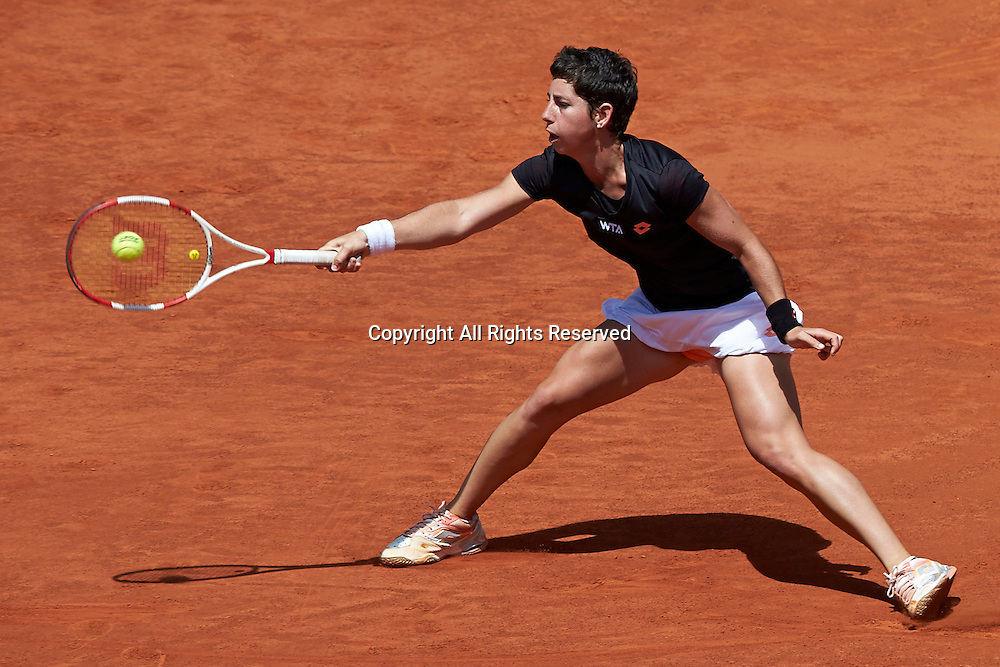 08.05.2014 Madrid, Spain. Carla Suarez of Spain stretches to play a forehand during the game with Serena Williams of USA on day 5 of the Madrid Open from La Caja Magica.