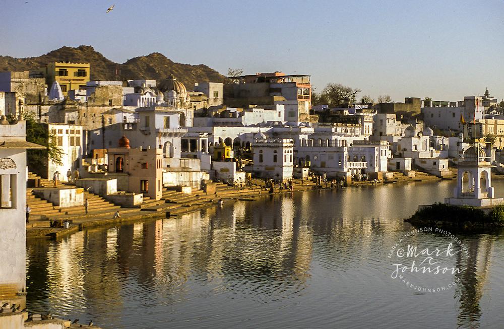 India, Rajasthan, Pushkar, Pushkar Lake, bathers use Ghats to visit the sacred waters.