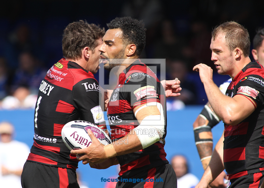 Ryan Atkins (C) of Warrington Wolves celebrates scoring the try with team mate Kurt Gidley (L) against Wakefield Trinity Wildcats during the Super 8s match at Belle Vue, Wakefield<br /> Picture by Stephen Gaunt/Focus Images Ltd +447904 833202<br /> 14/08/2016