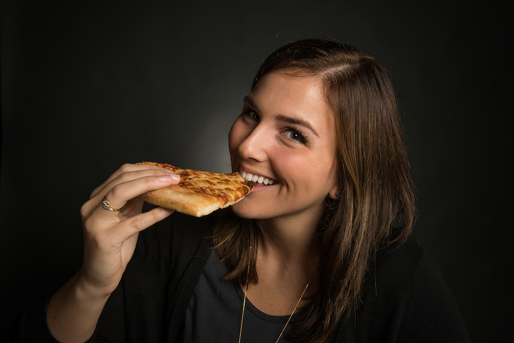 Jayne Seymour, Web Editor for Ohio University's Office of Diversity and Inclusion, poses with a slice of pizza on Tuesday, October 18, 2016.