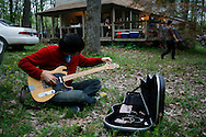 "Dustin Wong of Ponytail of Baltimore, Maryland tunes up before he performs during  an outside music show at a house during the Spirit of '68 sponsored Cookout and music performances at ""the Compound"" in Ellettsville near Bloomington, Indiana. May 2, 2008. Ponytail is an experimental band from Baltimore, Maryland, formed in 2005 by Jeremy Sigler as a class project - from MySpace. ."