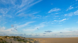 Deserted beach and dunes with rising moon, Texel, the Netherlands