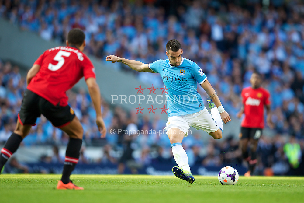 MANCHESTER, ENGLAND - Sunday, September 22, 2013: Manchester City's Alvaro Negredo in action against Manchester United during the Premiership match at the City of Manchester Stadium. (Pic by David Rawcliffe/Propaganda)
