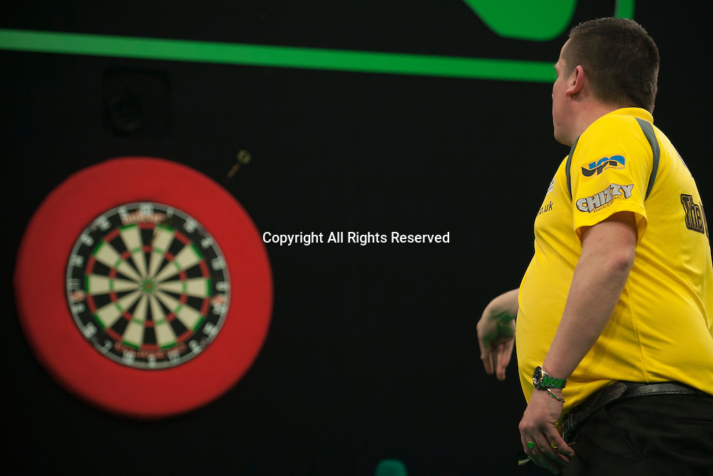 31.01.2016. ArenaMK, Milton Keynes, England. Unibet Masters Darts Championship.  Dave Chisnall [ENG] in action during his semi final against James Wade [ENG]. Dave Chisnall [ENG] won the match 11-6.