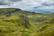 See the Quiraing landslip from a short hike up Bioda Buidhe. Bioda Buidhe mountain is a short, scenic walk along Trotternish Ridge, with views south to eroded landslips and north to the Quiraing, an active landslip. Photos here are taken from a hike 2.2 miles round trip with 700 feet gain, starting southwards from the summit of the minor road between Staffin and Uig, on the Isle of Skye, Scotland, United Kingdom, Europe.