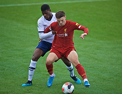 KIRKBY, ENGLAND - Saturday, August 10, 2019: Liverpool's substitute Bobby Duncan (R) and Tottenham Hotspur's captain TJ Eyoma during the Under-23 FA Premier League 2 Division 1 match between Liverpool FC and Tottenham Hotspur FC at the Academy. (Pic by David Rawcliffe/Propaganda)