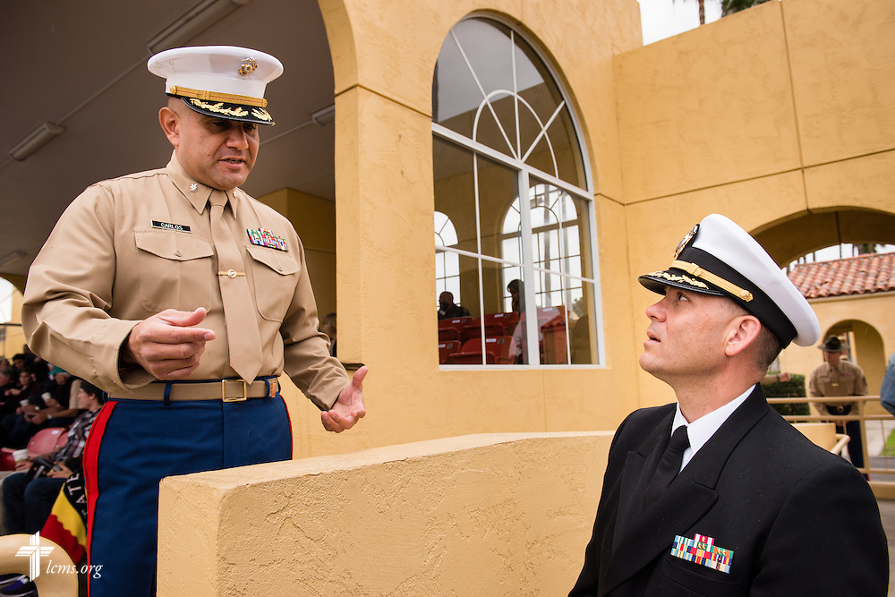 Cmdr. Charles E. Varsogea (right), chaplain at the Marine Corps Recruit Depot, chats Friday, Jan. 30, 2015, with an officer at the recruit graduation ceremony at the depot in San Diego, Calif. LCMS Communications/Erik M. Lunsford