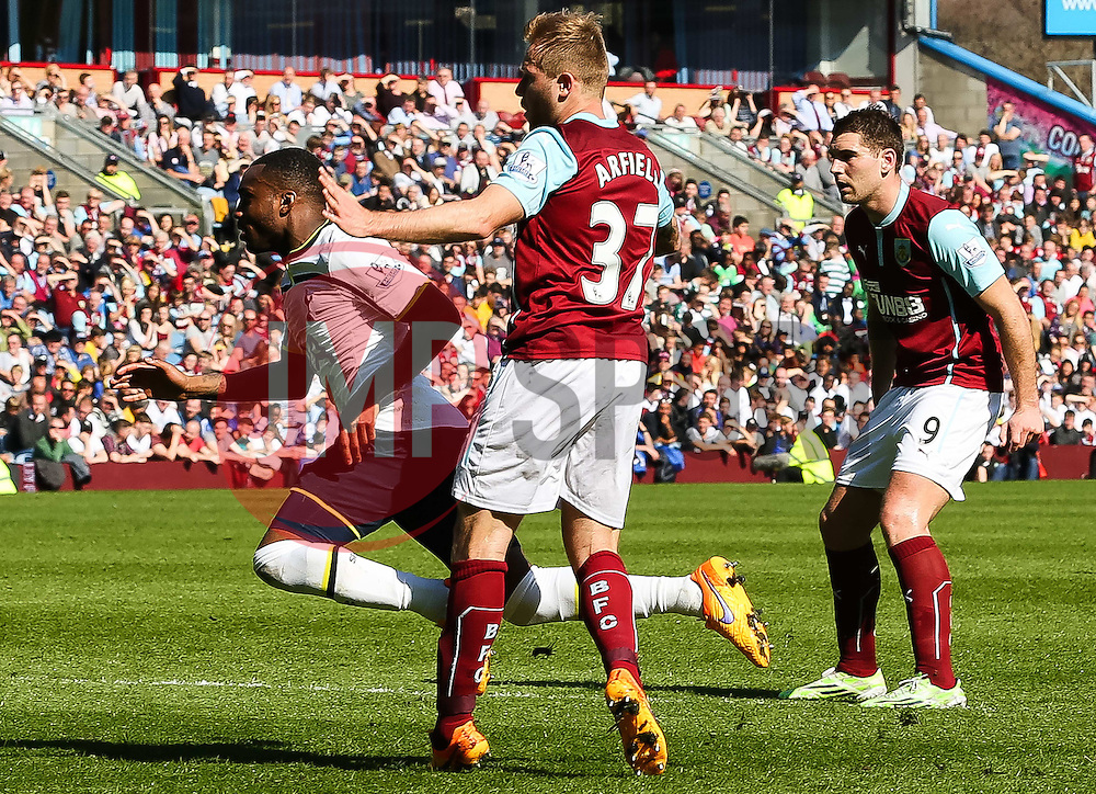 Tottenham Hotspur's Danny Rose goes down after a challenge from Burnley's Scott Arfield - Photo mandatory by-line: Matt McNulty/JMP - Mobile: 07966 386802 - 05/04/2015 - SPORT - Football - Burnley - Turf Moor - Burnley v Tottenham Hotspur - Barclays Premier League