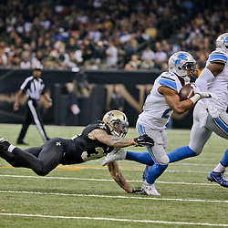 Dec 21, 2015; New Orleans, LA, USA; Detroit Lions running back Ameer Abdullah (21) escapes from New Orleans Saints strong safety Kenny Vaccaro (32) during the second quarter a game at the Mercedes-Benz Superdome. Mandatory Credit: Derick E. Hingle-USA TODAY Sports