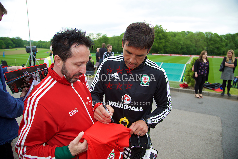 CARDIFF, WALES - Wednesday, June 1, 2016: Wales' manager Chris Coleman signs autographs for supporters after a training session at the Vale Resort Hotel ahead of the International Friendly match against Sweden. (Pic by David Rawcliffe/Propaganda)