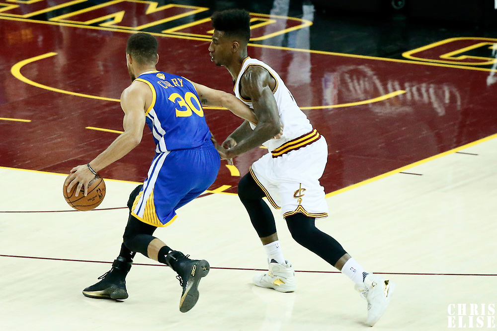 09 June 2017: Golden State Warriors guard Stephen Curry (30) drives past Cleveland Cavaliers guard Iman Shumpert (4) during the Cleveland Cavaliers 137-11 victory over the Golden State Warriors, in game 4 of the 2017 NBA Finals, at  the Quicken Loans Arena, Cleveland, Ohio, USA.