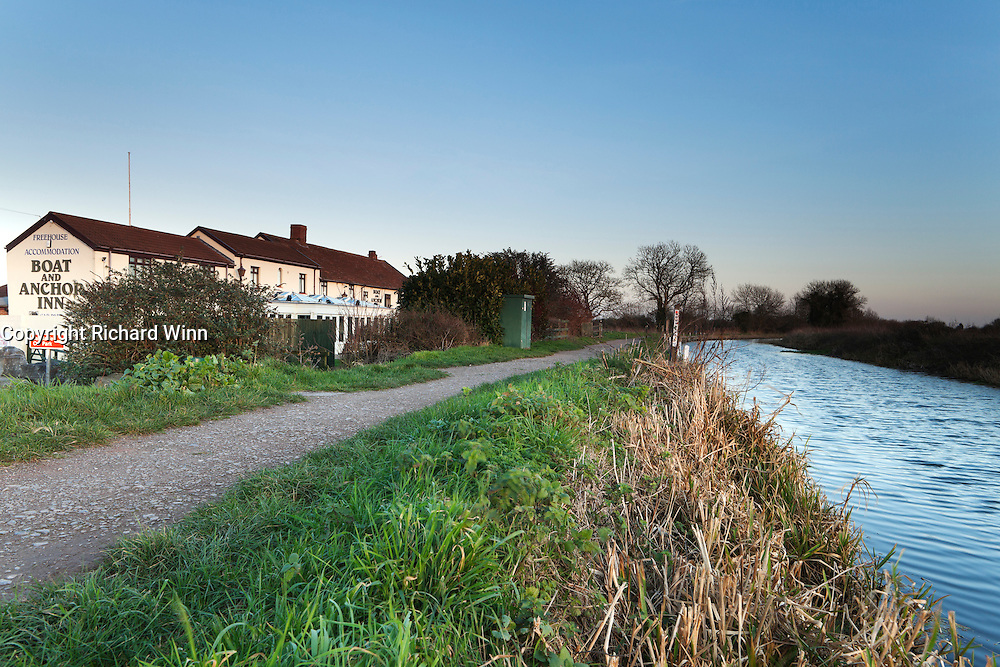View of the Boat and Anchor Inn, showing its position alongside the Bridgwater and Taunton Canal. Photographed in early evening, demonstrating its prime location for a drink after an evening walk.