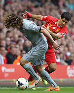 Luis Suarez of Liverpool and Fabrizio Coloccini of Newcastle United in action during the Barclays Premier League match at Anfield, Liverpool.<br /> Picture by Michael Sedgwick/Focus Images Ltd +44 7900 363072<br /> 11/05/2014