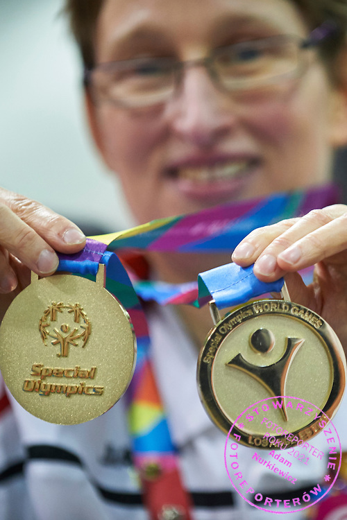 SO Poland athletes Teresa Cichy poses with gold medals after medal ceremony after bowling competition during fifth day of the Special Olympics World Games Los Angeles 2015 on July 29, 2015 at Los Angeles Convention Centre in Los Angeles, USA.<br /> <br /> USA, Los Angeles, July 29, 2015<br /> <br /> Picture also available in RAW (NEF) or TIFF format on special request.<br /> <br /> For editorial use only. Any commercial or promotional use requires permission.<br /> <br /> Adam Nurkiewicz declares that he has no rights to the image of people at the photographs of his authorship.<br /> <br /> Mandatory credit:<br /> Photo by &copy; Adam Nurkiewicz / Mediasport