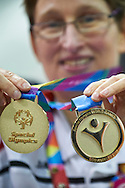 SO Poland athletes Teresa Cichy poses with gold medals after medal ceremony after bowling competition during fifth day of the Special Olympics World Games Los Angeles 2015 on July 29, 2015 at Los Angeles Convention Centre in Los Angeles, USA.<br /> <br /> USA, Los Angeles, July 29, 2015<br /> <br /> Picture also available in RAW (NEF) or TIFF format on special request.<br /> <br /> For editorial use only. Any commercial or promotional use requires permission.<br /> <br /> Adam Nurkiewicz declares that he has no rights to the image of people at the photographs of his authorship.<br /> <br /> Mandatory credit:<br /> Photo by © Adam Nurkiewicz / Mediasport