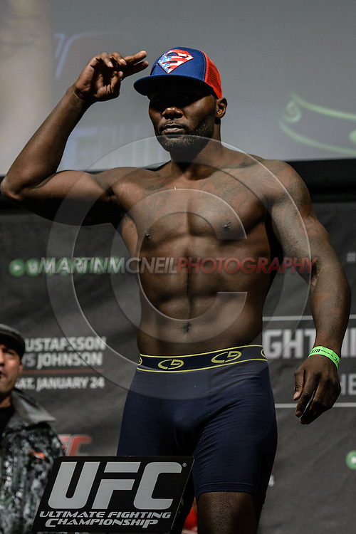 "STOCKHOLM, SWEDEN, JANUARY 23, 2015: Anthony Johnson poses on the scales during the official weigh in for ""UFC on Fox 14: Gustafsson vs. Johnson"" inside Hovet Arena in Stockholm, Sweden"
