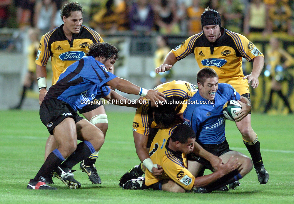 Scott Staniforth is brought down during the 2006 Super 14 rugby union match between the Hurricanes and the Western force at Yarrow Stadium, New Plymouth, on Saturday 18 February, 2006. Photo: John Cowpland/PHOTOSPORT