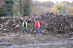 © Licensed to London News Pictures.18/11/2017.<br />Orpington, UK.<br /> Workmen and the last of the waste.<br />The infamous Waste4fuel rubbish site in Orpington is due to be totally clear of waste on Monday. Work began to clear the site from 27.000 tons of waste a year ago at Cornwall Drive, Now the site has about 27 tons of rubbish left to clear. Altogether the clearance cost of the waste mountain has come to around £4.5 million with most of the money coming from government and the Enviroment Agency.<br />Photo credit: Grant Falvey/LNP