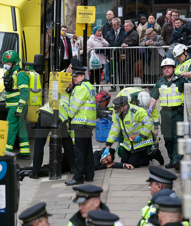 © Licensed to London News Pictures. 22/02/2012. London, UK.  Police and paramedics attend to an actor playing an injured man during an Olympic security test event at Aldwych tube station in central London today (22/02/2012). The  two-day exercise is being run in a disused tube station to test security in run up to the London Olympics this summer. Photo credit : Ben Cawthra/LNP
