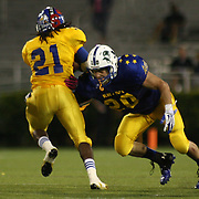 Blue Troy Staker (20) of Brandywine High School attempts to tackle Gold Donovan Cain (21) of Dover High School in the fourth-quarter of the 58th Annual DFRC Blue-Gold All-Star Football game Saturday, June. 22, 2013, at Delaware Stadium in Newark DE.