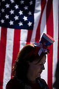 Carolyn Pagin of Bay Area Entertainment Network is silhouetted against the American flag while she creates balloon animals during the Independence Day Pool Party at the Milpitas Sports Center in Milpitas, California, on July 4, 2015. (Stan Olszewski/SOSKIphoto)