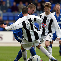 St Johnstone v St Mirren..  19.10.02<br />Ryan Stevenson is blocked by Brian McGinty and Ricky Gillies<br /><br />Pic by Graeme Hart<br />Copyright Perthshire Picture Agency<br />Tel: 01738 623350 / 07990 594431
