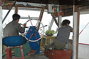 Myanmar Mandalay Transportation on the Ayeyarwady River Local men at the helm of the boat