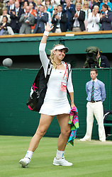 LONDON, ENGLAND - Thursday, June 30, 2011: Sabine Lisicki (GER) waves goodbye to the crowd after losing the Ladies' Singles Semi-Final match on day ten of the Wimbledon Lawn Tennis Championships at the All England Lawn Tennis and Croquet Club. (Pic by David Rawcliffe/Propaganda)