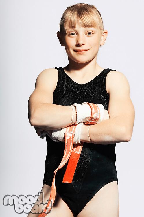 Gymnast (13-15) in leotard wearing palm guards portrait