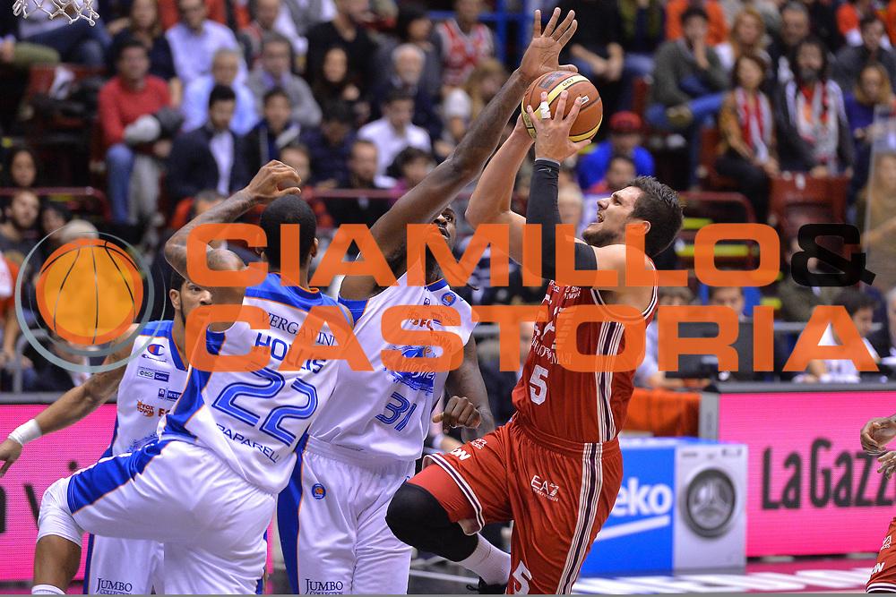 DESCRIZIONE : Milano Lega A 2014-15  EA7 Emporio Armani Milano vs Acqua Vitasnella Cant&ugrave;<br /> GIOCATORE : Alessandro Gentile<br /> CATEGORIA : Tiro<br /> SQUADRA : EA7 Emporio Armani Milano<br /> EVENTO : Campionato Lega A 2014-2015<br /> GARA : EA7 Emporio Armani Milano vs Acqua Vitasnella Cant&ugrave;<br /> DATA : 16/11/2014<br /> SPORT : Pallacanestro <br /> AUTORE : Agenzia Ciamillo-Castoria/I.Mancini<br /> Galleria : Lega Basket A 2014-2015  <br /> Fotonotizia : Milano Lega A 2014-2015 Pallacanestro : EA7 Emporio Armani Milano vs Acqua Vitasnella Cant&ugrave;<br /> Predefinita :