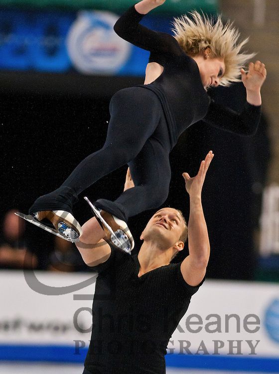 Caydee Denney is tossed into the air by her partner Jeremy Barrett while practicing their pairs routine during the U.S. Figure Skating Championships in Greensboro, North Carolina on January 25, 2011. REUTERS/Chris Keane (UNITED STATES)