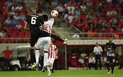 August 2, 2017 - Piraeus, Attiki, Greece - El Fardou Ben Nabouhane (no 31) of Olympiacos and Lazar Cirkovic (no 6) of Partizan vindicate the ball during the game. (Credit Image: © Dimitrios Karvountzis/Pacific Press via ZUMA Wire)