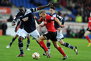 Cardiff city's Craig Bellamy goes past Danny Shittu (3).  NPower championship, Cardiff city v Millwall at the Cardiff city stadium in Cardiff, South Wales on Saturday 29th Dec 2012. pic by Andrew Orchard, Andrew Orchard sports photography,