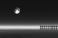 This combination of the moon with a pier is certain to appeal to those who love a sense of mystery. There is noir quality to this piece that cannot be denied. At the same time, there is also a quality to this piece that makes us feel as though we have been transported to another dimension entirely. Whether or not you believe that to be the case, there is definitely something of a supernatural tone to the atmosphere of this piece. There is no question that you can enjoy this fine art piece in just about any space you may want.