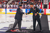 REGINA, SK - MAY 27:Brigadier-General Trevor Cadieu of the Canadian Armed Forces shakes hands with Ken Eskdale of the Royal Canadian Legion at centre ice for the ceremonial puck drop at the Brandt Centre on May 27, 2018 in Regina, Canada. (Photo by Marissa Baecker/CHL Images)