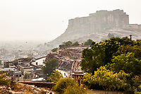 Looking up through the polluted air towards Mehrangarh Fort which stands above the city of Jodhpur, Rajasthan, India.