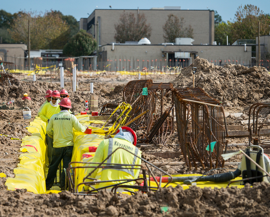 Construction crews work on the new Furr High School, December 15, 2015.